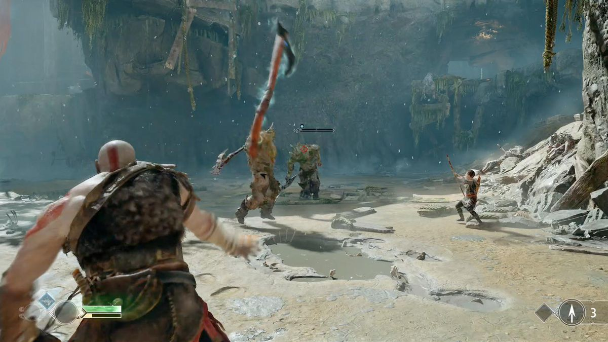 God of War - Kratos throwing his ax at an enemy while Atreus fires an arrow