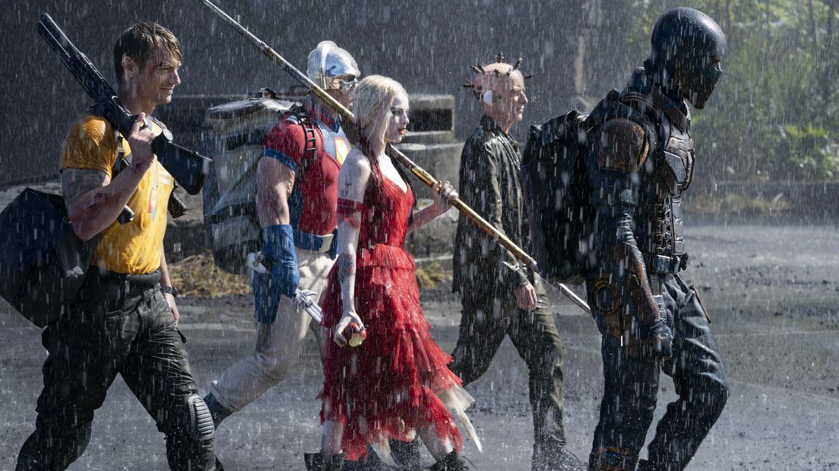 The Suicide Squad walks in the rain
