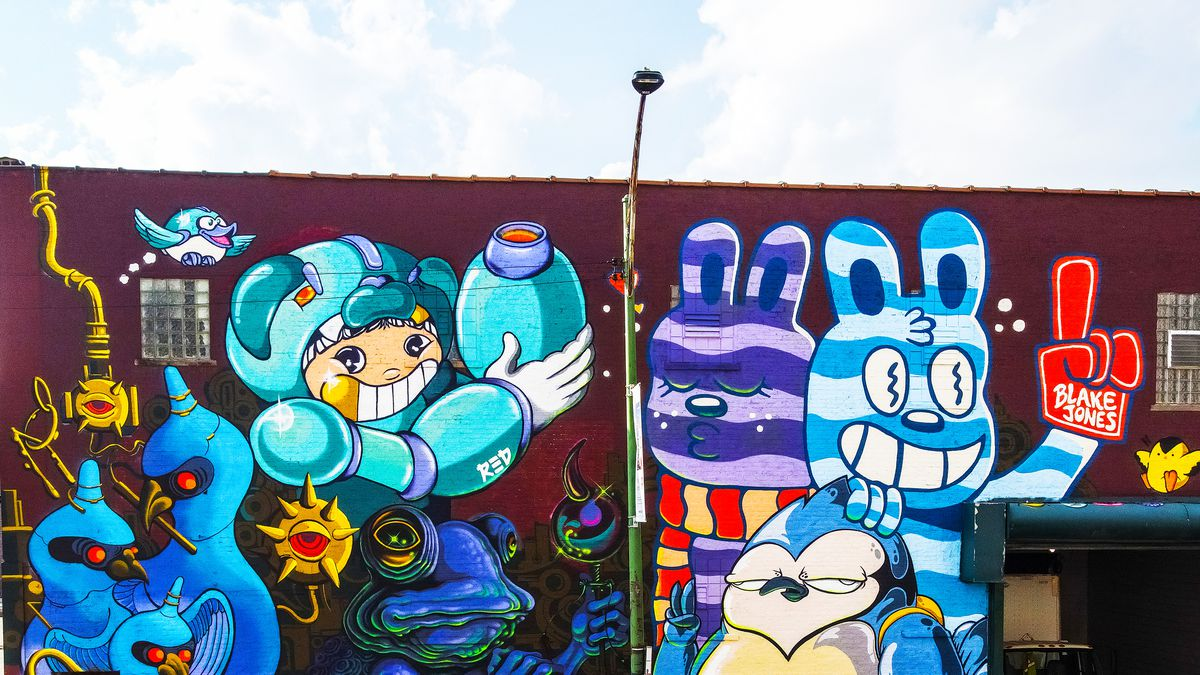 This mural at 901 W. Lake St. features signature characters from five artists and is part of a growing collection of murals in the West Loop.