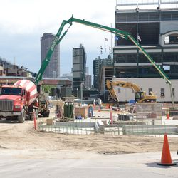 11:30 a.m.  Concrete being poured, on the Waveland Avenue side of the triangle lot -