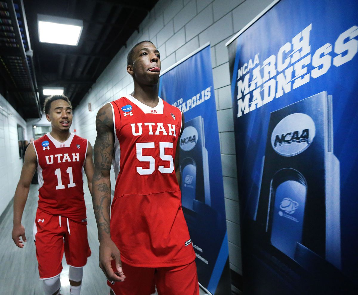 Utah Utes guard Brandon Taylor (11) and teammate Utah Utes guard Delon Wright (55) walk to the locker room after defeating Georgetown, 75-64, Saturday, March 21, 2015, in the third round of the NCAA Tournament at the Moda Center in Portland, Oregon. The Utes advance to the Sweet 16.