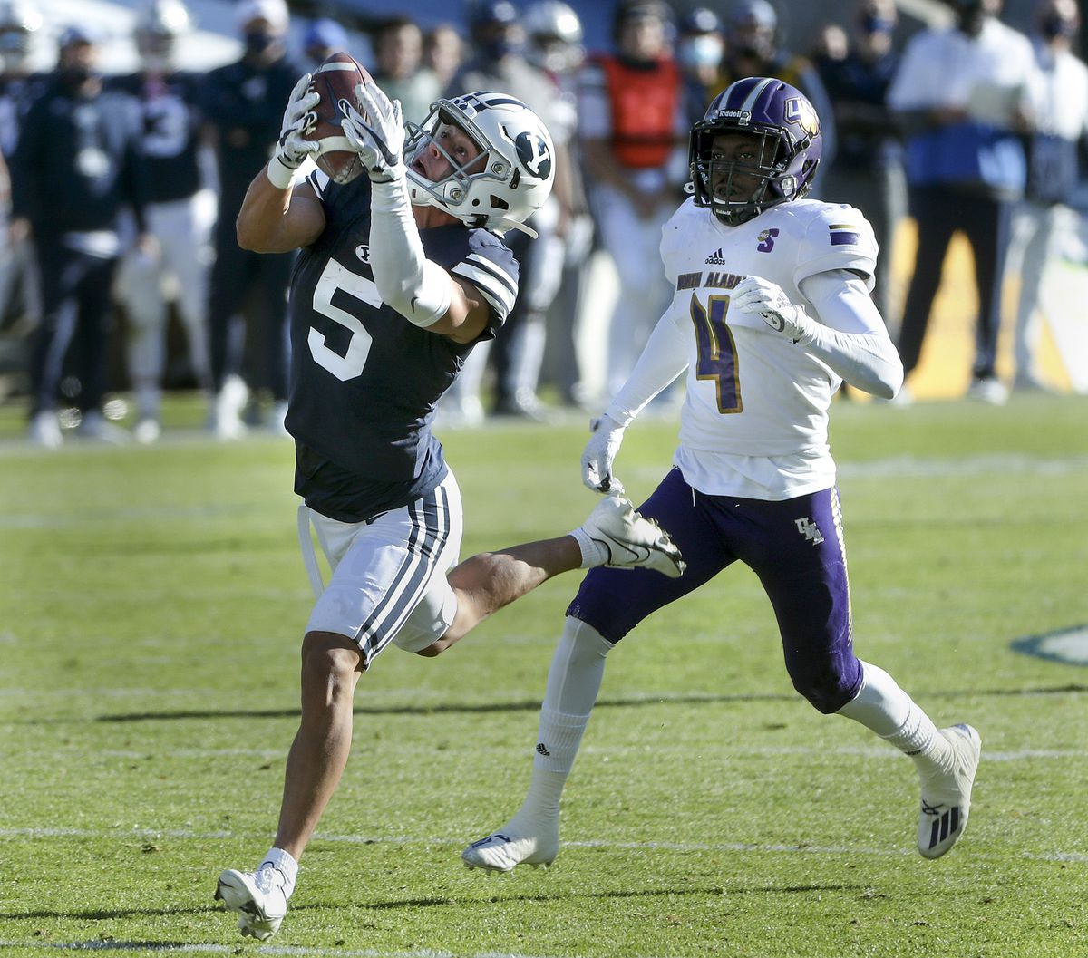 Brigham Young Cougars wide receiver Dax Milne (5) hauls in a long pass over North Alabama Lions cornerback Will Singleton (4) during a game in Provo on Saturday, Nov. 21, 2020.