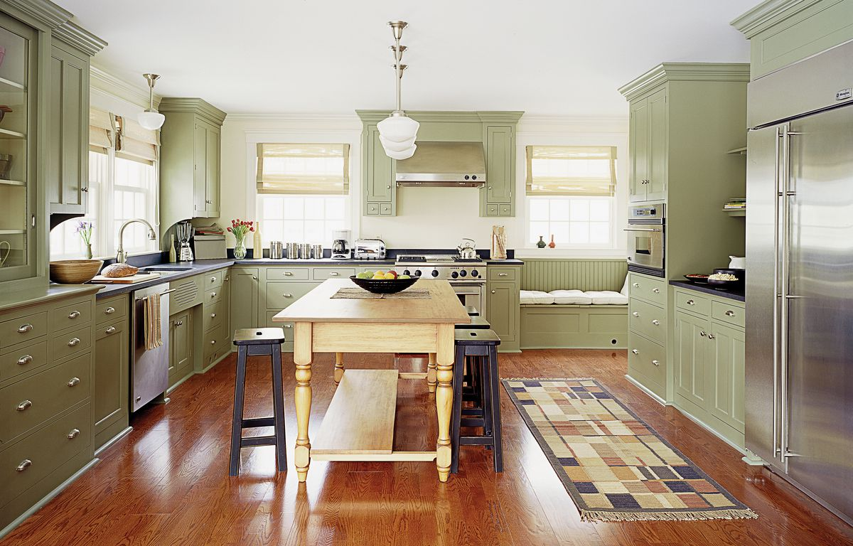 <p>Mahogany stain on this engineered red oak floor from Harris Wood warms up the kitchen of a Winchester, Mass., home remodeled by TOH TV.</p>