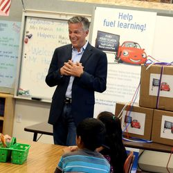 Former U.S. Ambassador to China, Utah Governor and current Chevron board of directors member Jon Huntsman Jr. speaks to fourth-graders before helping them unwrap STEM-related teaching materials at Rose Park Elementary School in Salt Lake City on Wednesday, Sept. 3, 2014.