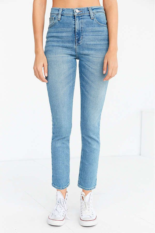 A pair of high rise light denim jeans
