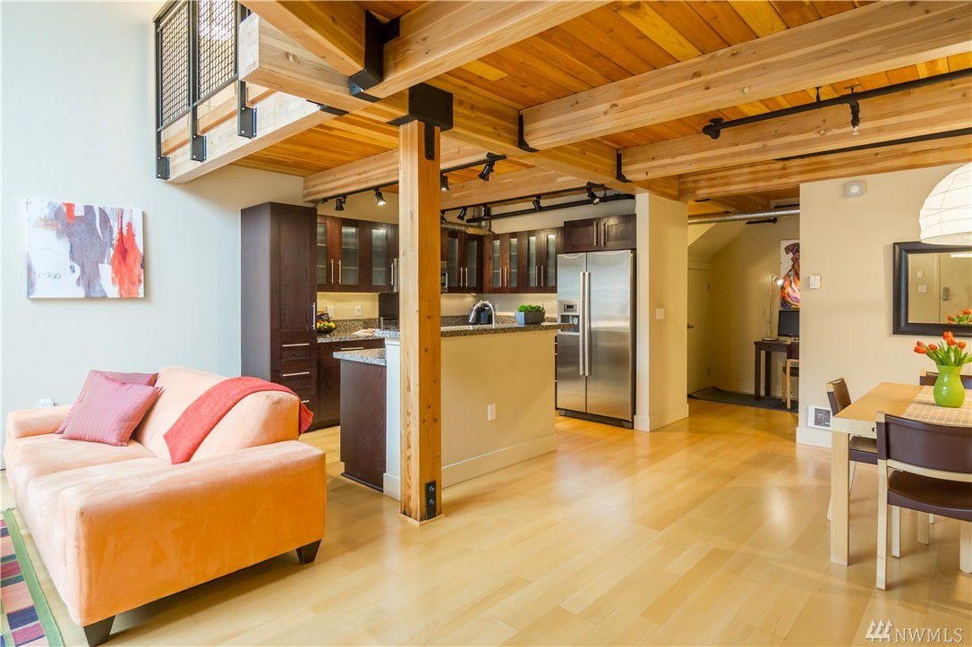 Condo interior features an exposed timber loft