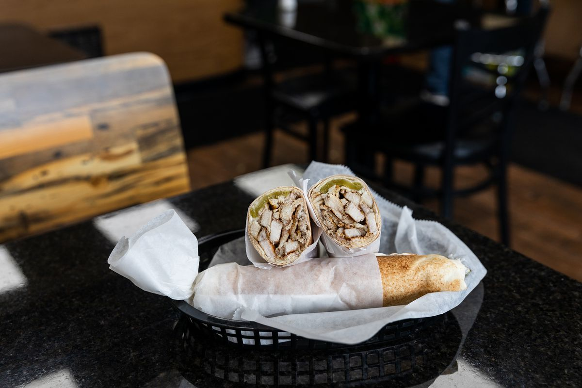 Chicken shawarma at Tuhama's in Dearborn sits in a black basket lined with white paper.