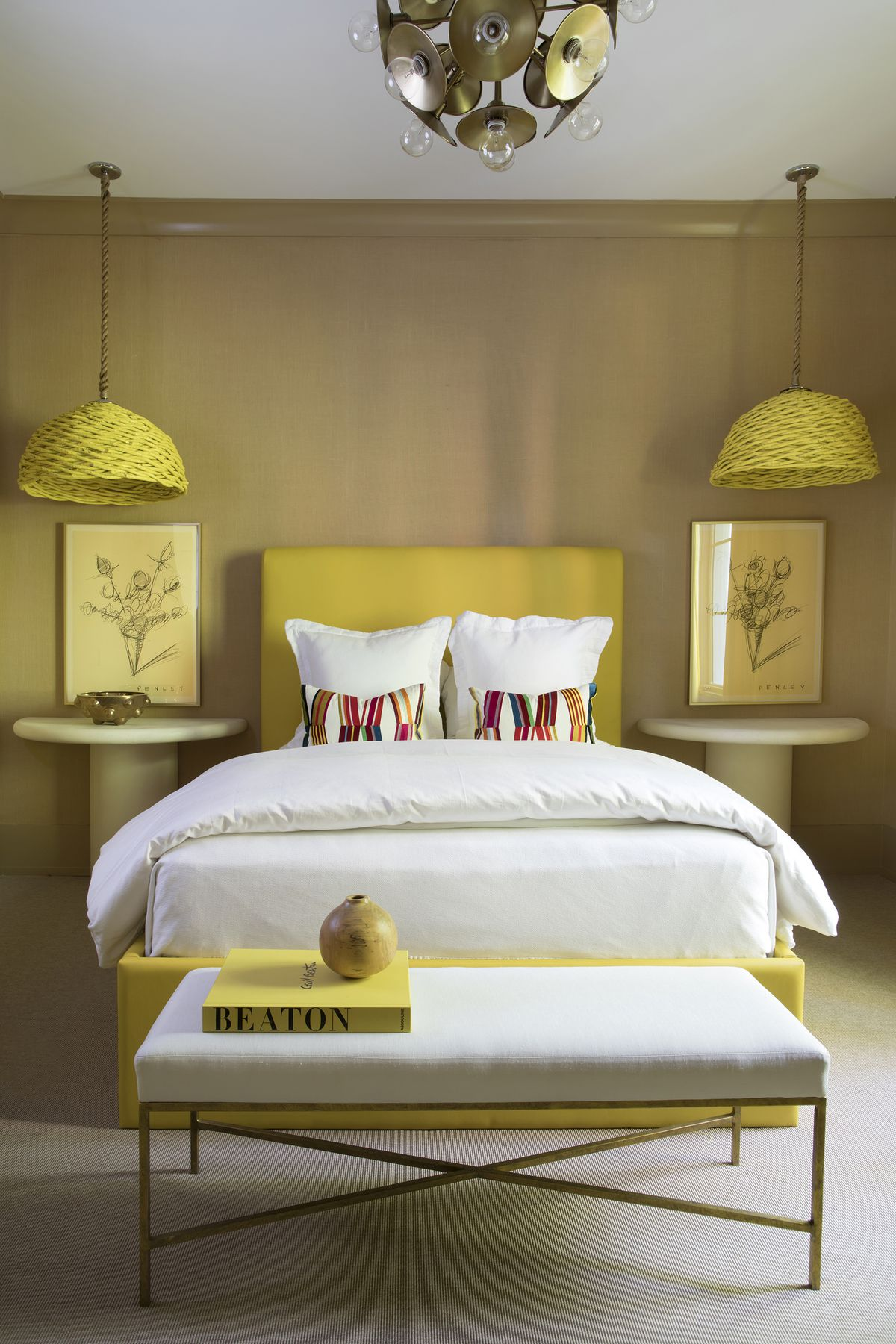Bright yellow accessories spice up an otherwise neutral bedroom.