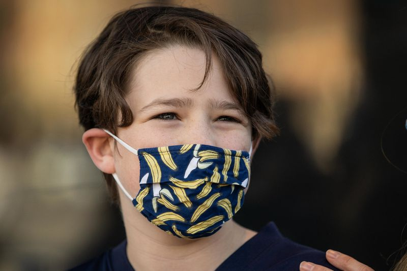 Liam Samet, 12, waits outside Wrigley Field on Thursday morning, May 13, 2021 before getting his COVID-19 vaccination.