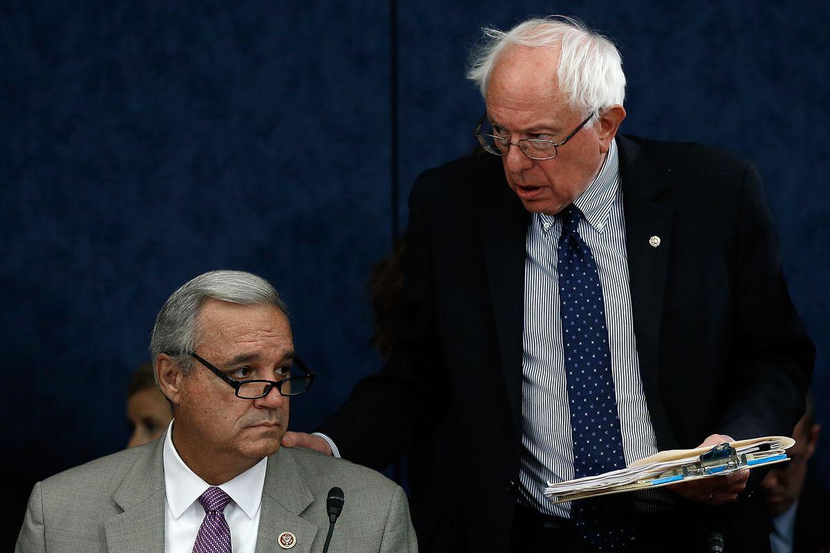 Senator Bernie Sanders (I-VT) and Representative Jeff Miller (R-FL) talk at congressional negotiations over the Veterans Affairs reform bill.