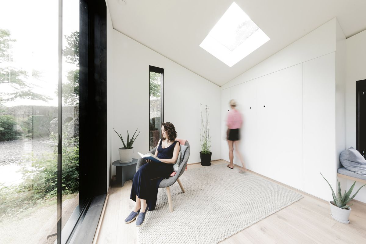 Woman reading in light-filled room