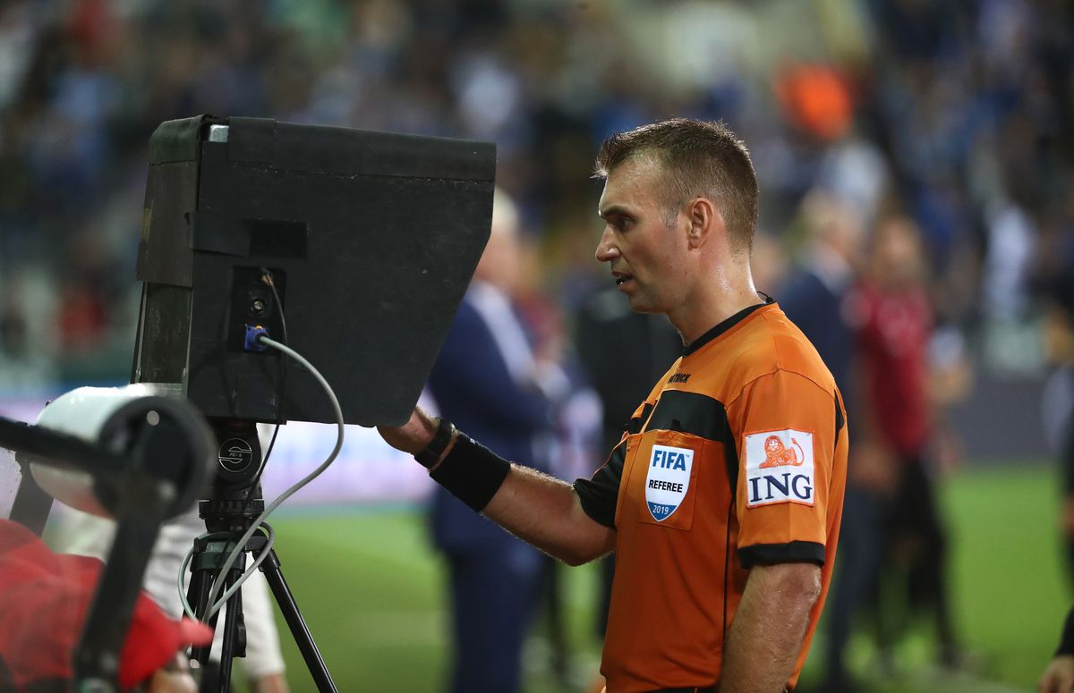 Referee using VAR - VAR is being introduced to the Premier League this season