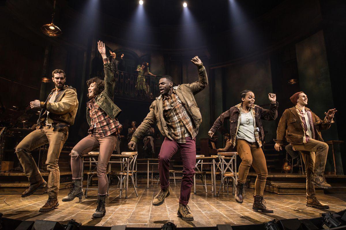 Five actors dance onstage