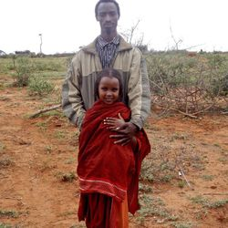 Tume Mida, 10, stands with her 22-year-old husband in the region of Borena, in the south of Ethiopia. Child marriage, such as with this young bride, in rural Ethiopia is not unusual.