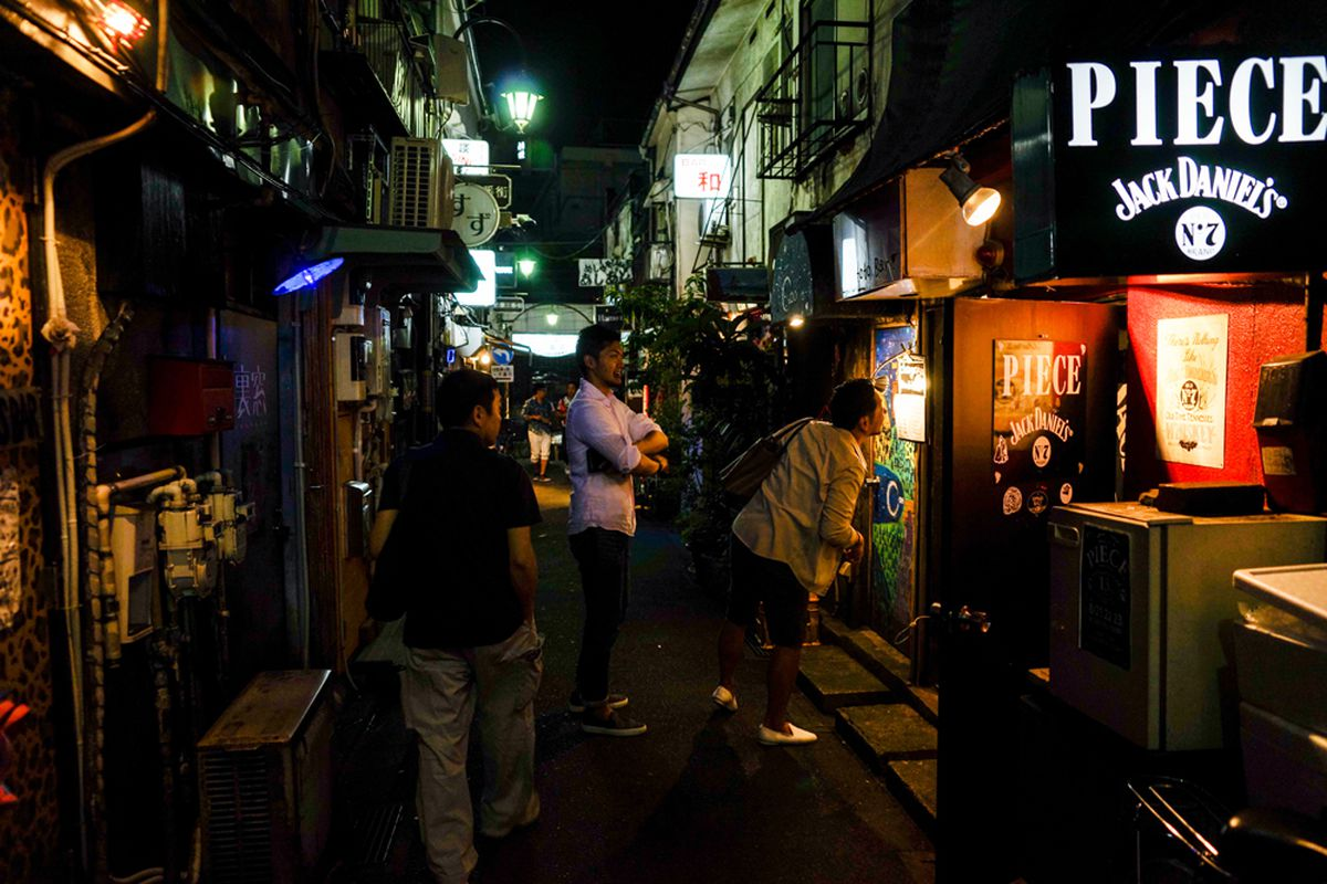 The Golden Gai bar district in Tokyo, famous for narrow streets and tiny, eclectic taverns.