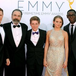 """The cast of """"Homeland"""", from left, Diego Klattenhoff, Mandy Patinkin, Jackson Pace, Morgan Saylor and David Harewood, arrives at the 64th Primetime Emmy Awards at the Nokia Theatre on Sunday, Sept. 23, 2012, in Los Angeles."""