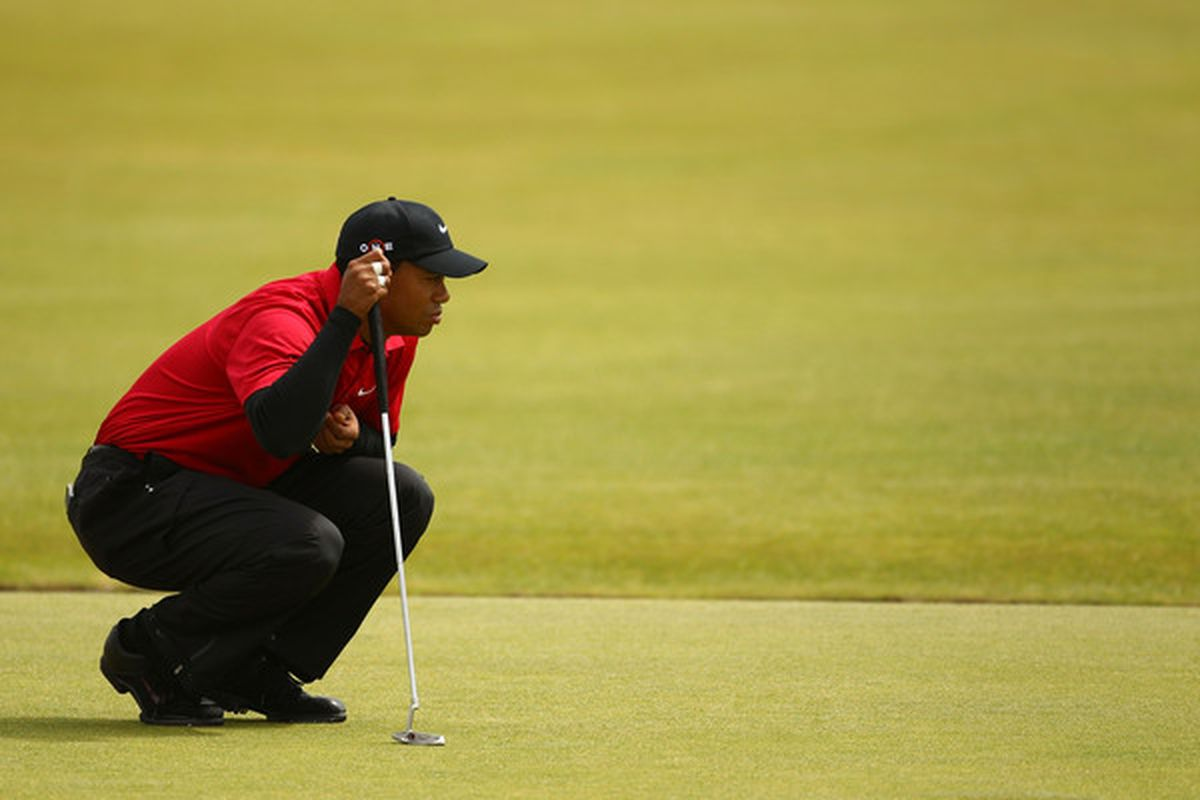 ST ANDREWS SCOTLAND - JULY 18:  Tiger Woods of the USA waits on the first green during the final round of the 139th Open Championship on the Old Course St Andrews on July 18 2010 in St Andrews Scotland.  (Photo by Richard Heathcote/Getty Images)