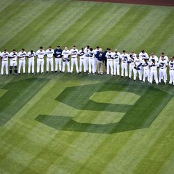 Prior to the game, the team gathered around Tony's number 19 in right field.