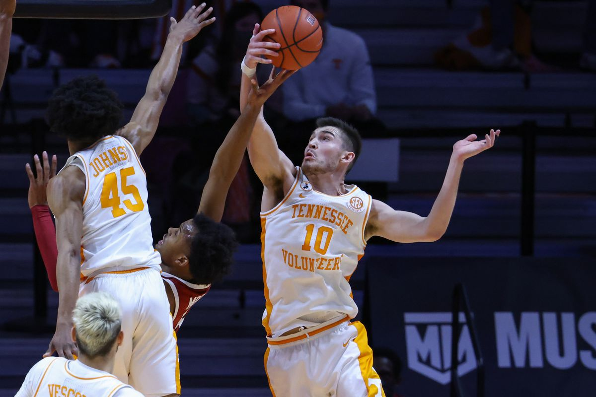 Arkansas Razorbacks guard Moses Moody has a shot blocked by Tennessee Volunteers forward John Fulkerson during the second half at Thompson-Boling Arena.
