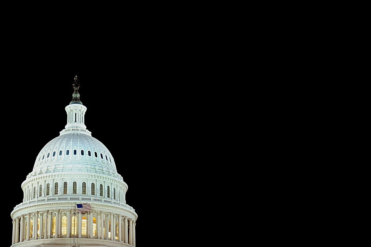 The US flag flies in front of the US Capitol dome on December 24, 2008 in Washington, DC.