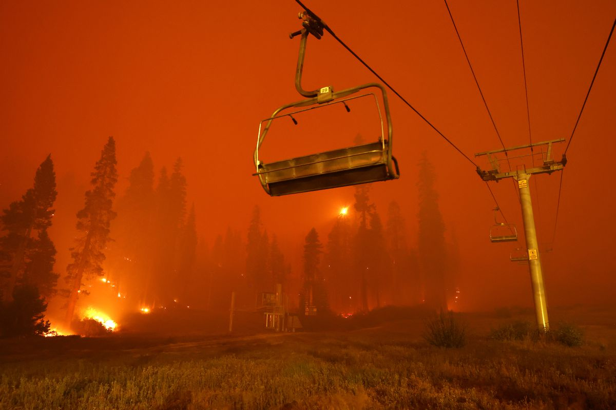 A chairlift at Sierra-at-Tahoe ski resort sits idle as the Caldor Fire moves through the area on August 30, 2021, in Twin Bridges, California.