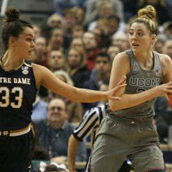 UConn's Katie Lou Samuelson (33) grabs a rebound from Notre Dame's Kathryn Westbeld (33) during the Notre Dame Fighting Irish vs UConn Huskies women's college basketball game in the Women's Jimmy V Classic at the XL Center in Hartford, CT on December 3, 2017.