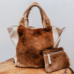 """Reversible tote, <a href=""""http://www.zeromariacornejo.com/#!/shop/shoes_and_accessories/reversible-tote-lhp"""">$1395</a>"""