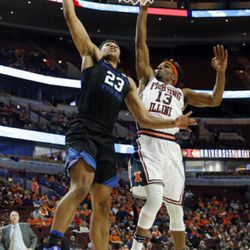 BYU forward Yoeli Childs, left, shoots against Illinois guard Tracy Abrams during the second half of an NCAA college basketball game Saturday, Dec. 17, 2016, in Chicago. Illinois won 75-73. (AP Photo/Nam Y. Huh)