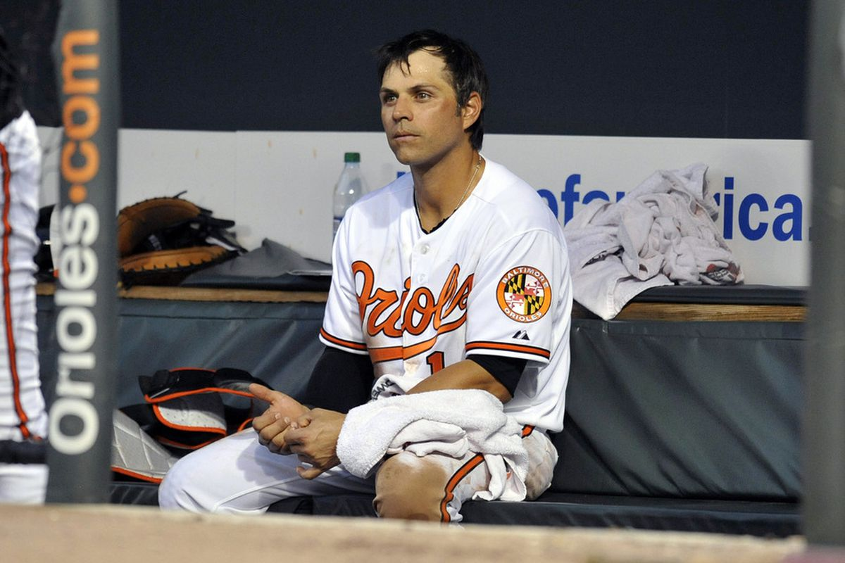 June 12, 2012; Baltimore, MD, USA; Baltimore Orioles second baseman Brian Roberts (1) on the bench during the third inning against the Pittsburgh Pirates at Oriole Park at Camden Yards. Mandatory Credit: Joy R. Absalon-US PRESSWIRE