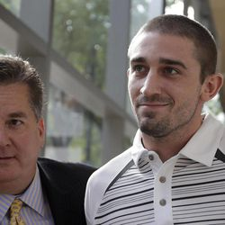 Kenneth W. Smith Jr., right, accompanied by his lawyer Bill Brennan exits the U.S. Courthouse, Friday, Sept. 7, 2012, in Philadelphia. Smith was arrested and is charged with making a hoax threat that led authorities to recall a plane in midair to the Philadelphia airport. Federal authorities charged 26-year-old Smith Jr. with conveying false and misleading information. According to a criminal complaint, Smith called police at the airport on Thursday, Sept. 6, 2012 and falsely reported a passenger was carrying an explosive substance. Authorities then recalled a Dallas-bound US Airways flight to Philadelphia.