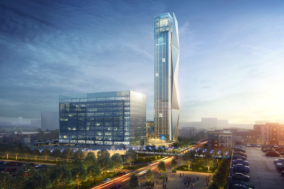 An older version of the rendering shows a tower with segmented accents on its side and a basic block for the lower office.