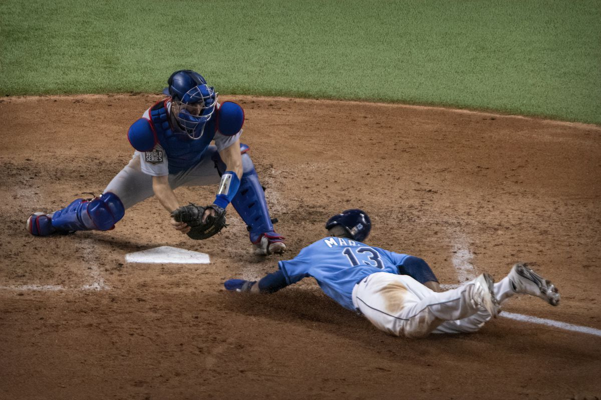 Los Angeles Dodgers catcher Austin Barnes (15) tags out Tampa Bay Rays left fielder Manuel Margot (13) as Margot attempts to steal home during the fourth inning in game five of the 2020 World Series at Globe Life Field.