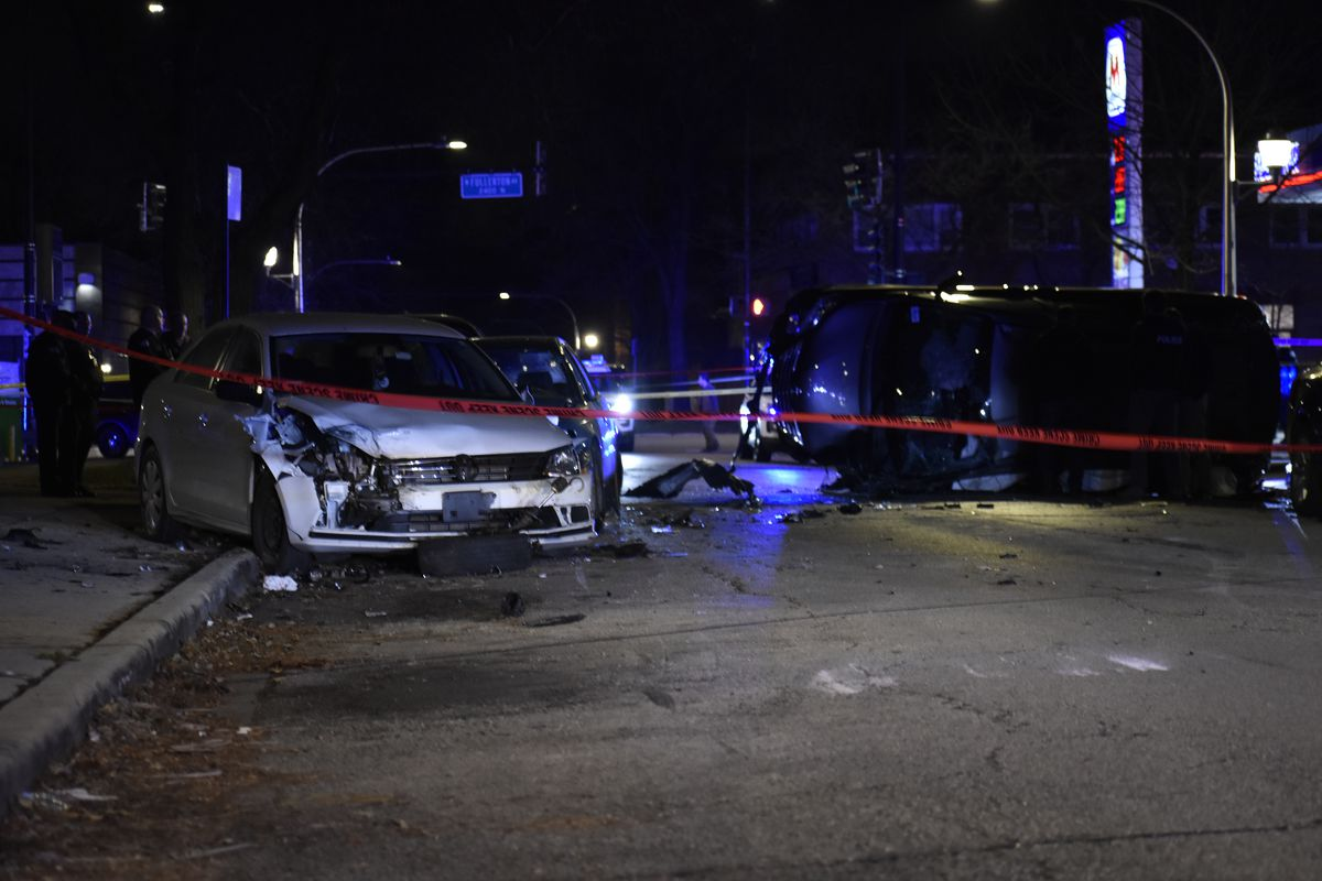 Chicago police investigate the scene where a stolen minivan crashed into multiple vehicles in the 2400 block of North Lamon Avenue in Cragin on the Northwest Side on Dec. 8, 2019.