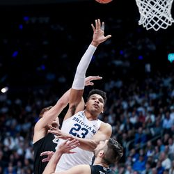 Brigham Young Cougars forward Yoeli Childs (23) goes to the hoop between Gonzaga Bulldogs forward Corey Kispert (24) and forward Killian Tillie (33) at the Marriott Center in Provo on Saturday, Feb. 22, 2020.