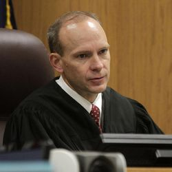 Fourth District Judge Derek Pullan gives jury instructions before closing arguments in the murder trial of former Pleasant Grove physician Martin MacNeill in Provo's 4th District Court on Friday, Nov. 8, 2013. MacNeill is charged with murder in the 2007 death of his wife, Michele MacNeill.