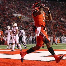 Utah Utes quarterback Troy Williams (3) celebrates his second touchdown of the night, putting the Utes up 28-0 over the Colorado Buffaloes after the PAT, at Rice-Eccles Stadium in Salt Lake City on Saturday, Nov. 25, 2017.