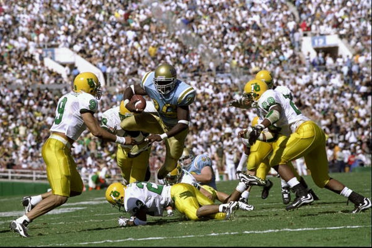 Foster running over the Ducks as a true freshman at the Rose Bowl. Mandatory Credit: Tom Hauck /Allsport