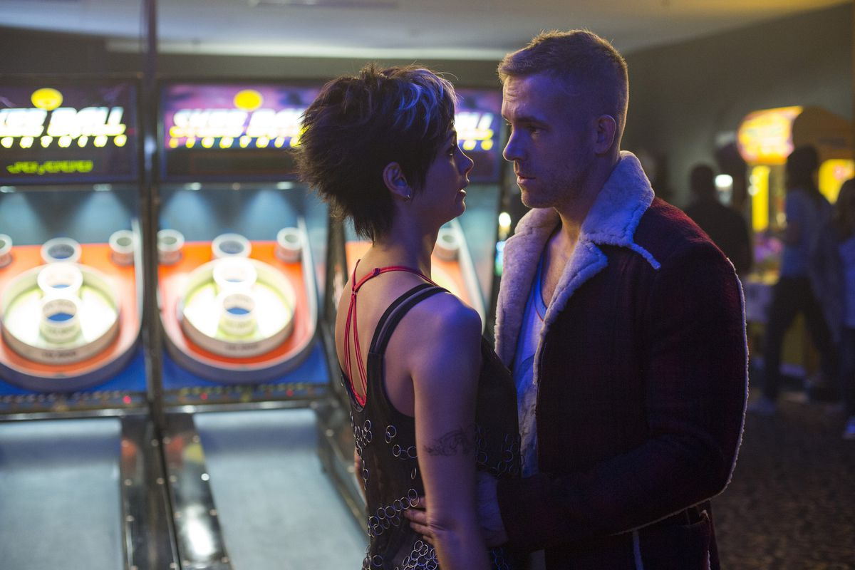 Morena Baccarin and Ryan Reynolds in Deadpool.