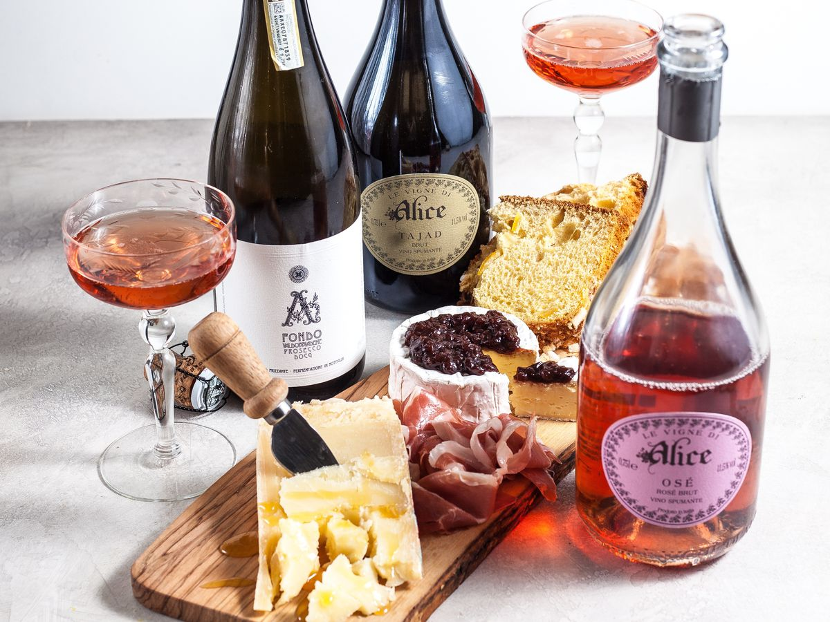 bottles and glasses of white and a board with cheese and dips