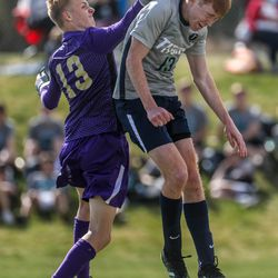 Syracuse's Jacob Packer (13) tries to head the ball while Davis' Jude Walker (13) tries to knock it away during a boys soccer match at Syracuse High School on Thursday, April 8, 2021.