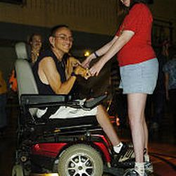 Justin Olson, left, and Tara Groneman dance together at the Copperview Community Center in Midvale.