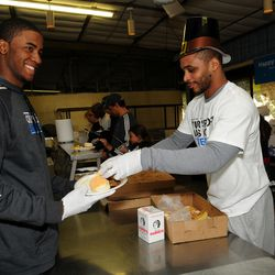 Orlando Magic's Jameer Nelson and Maurice Harkless serving meals at the Coalition for the Homeless.  The Magic and Coalition for the Homeless hosted its 20th annual Thanksgiving breakfast for more than 800 men, women and children at the facility.