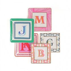 "<a href=""http://www.cwonder.com/all-for-mom-gift-guide/monogram-decorative-plate.html"">C. Wonder monogram plates</a>, $38 each, cwonder.com"