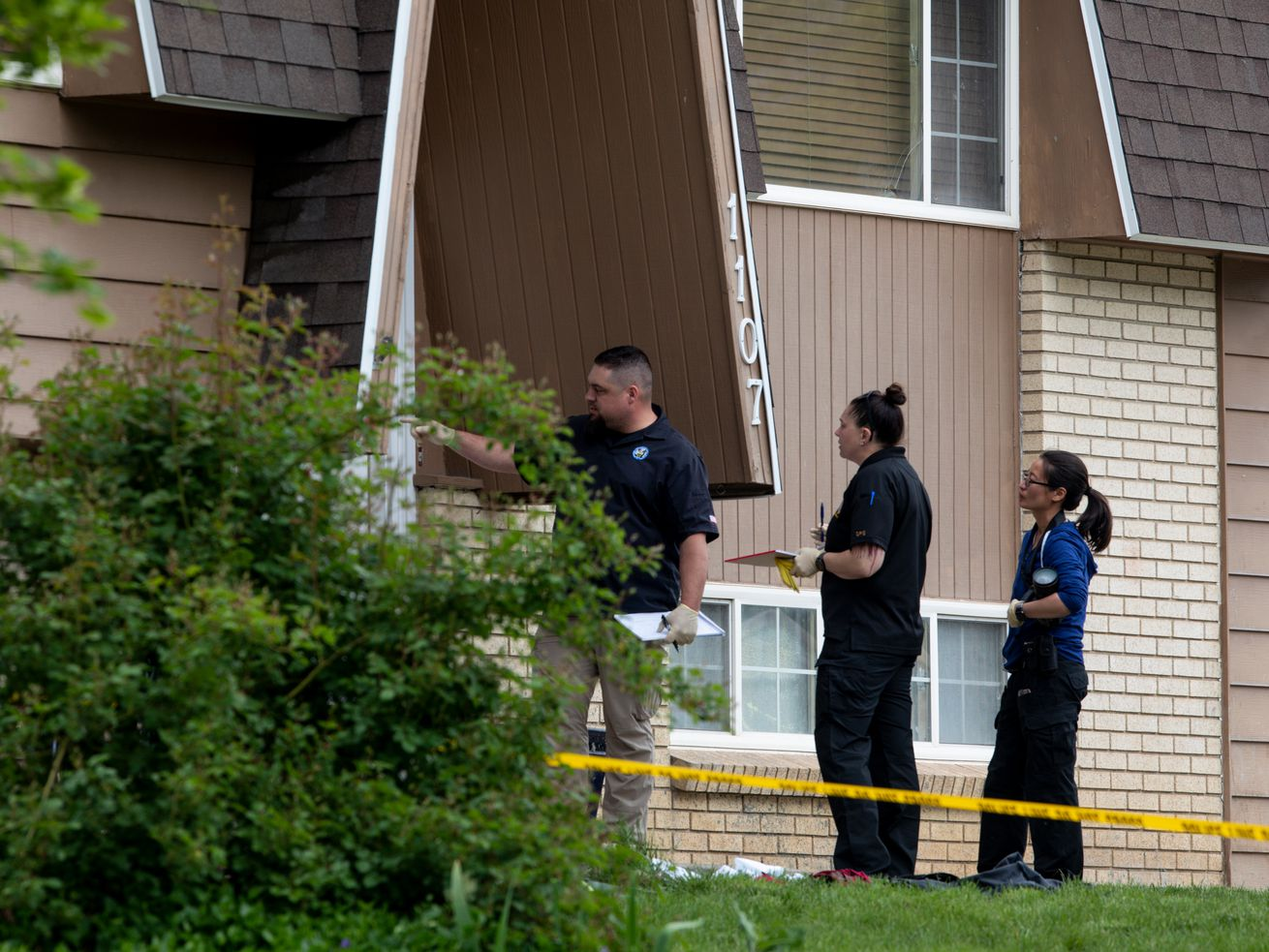 Police investigate a scene where a 17-year-old was killed after being shot outside his home near 1100 East and Saphire Drive (9600 South) in Sandy on Friday, May 22, 2020.