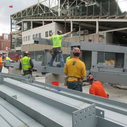 3:02 p.m. Another section being lowered into place -