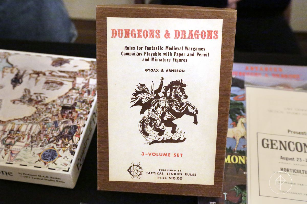 First edition of the original three-volume boxed set of Dungeons & Dragons. Faux woodgrain, with the cover of a knight on horseback applied as a sticker to the top of the box. From the Horticultural Hall in Lake Geneva, Wisconsin in 2017.