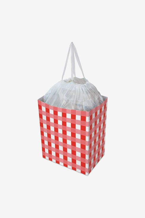A cube-shaped disposable trash can in a red gingham pattern