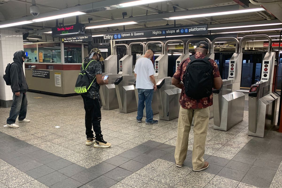 Early morning commuters wait for subway turnstiles to open at Penn Station, Aug. 27, 2020.