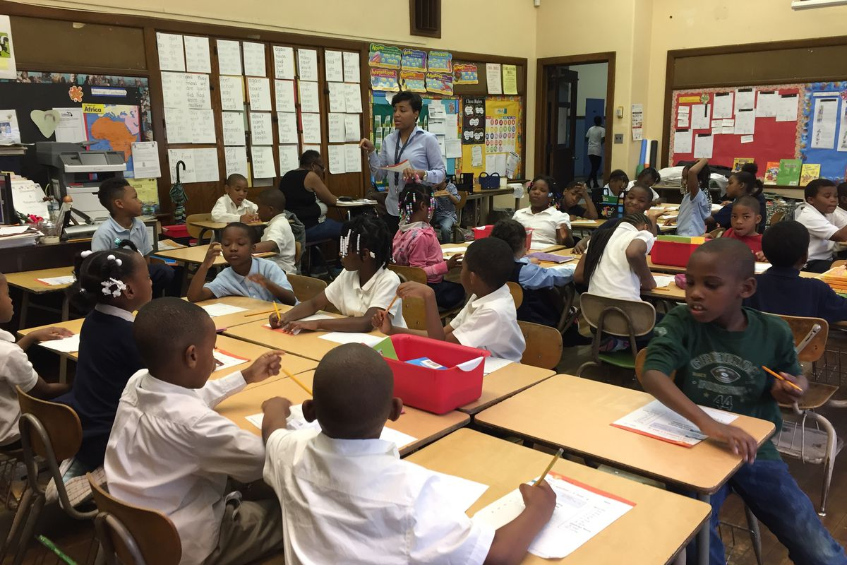 """Rynell Sturkey, a first-grade teacher at Paul Robeson Malcolm X Academy on Detroit's west side often manages jam-packed classrooms of 37 kids or more. Her students have no music or art or gym. """"They're with me all day in this room. We're tired,"""" she said."""