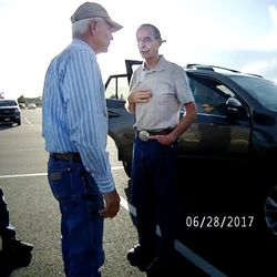 """Salt Lake County Recorder Gary Ott, center, talks with family members, left, and a Pleasant View police officer in body camera footage taken in a Harrisville parking lot on Wednesday, June 28, 2017. The footage shows the exchange Ott's family and his self-described """"longtime friend"""" Karmen Sanone had with police the day a judge signed a temporary order granting Ott's family legal guardianship amid concerns about his health."""